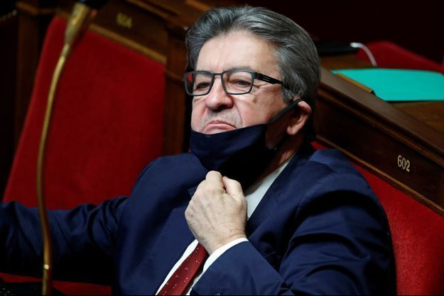 Jean-Luc Melenchon, leader of far-left opposition La France Insoumise (France Unbowed) political party and member of parliament, wearing a protective face mask, attends the questions to the government session at the National Assembly in Paris amid the coronavirus disease (COVID-19) in France, January 12, 2021. REUTERS/Gonzalo Fuentes